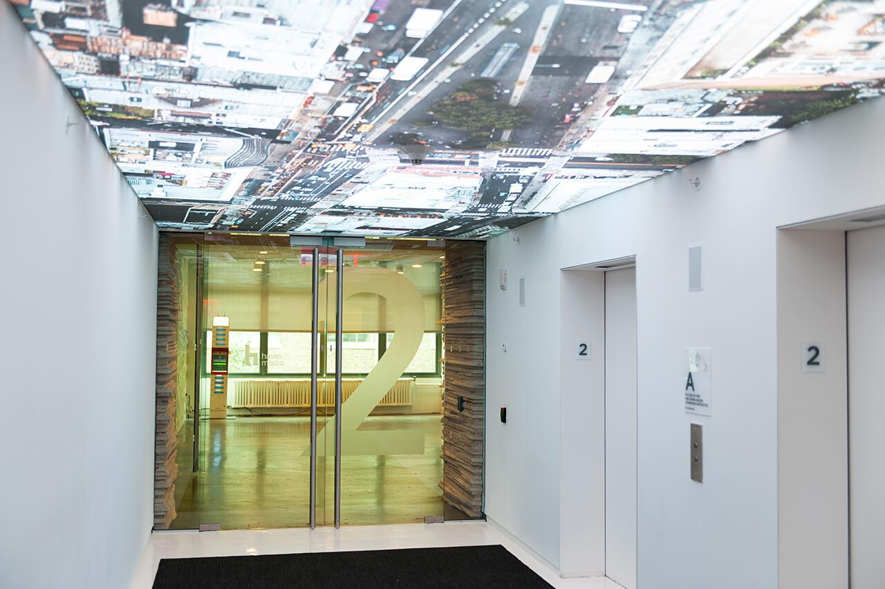 Functional-art_Havas_NYC_2nd-floor-elevator-lobby-backlit-ceilig